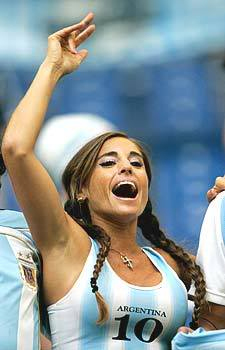 Argentina girls cheering on their team with messi jersey on
