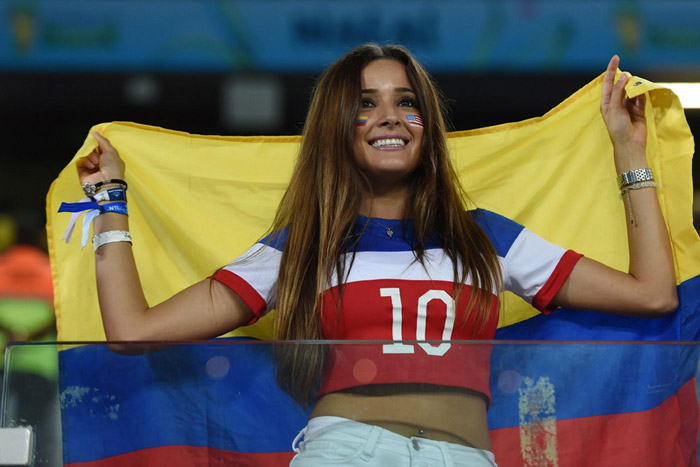 Colombian soccer fan sports USA flag too
