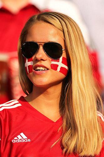 Denmark women watching the soccer game