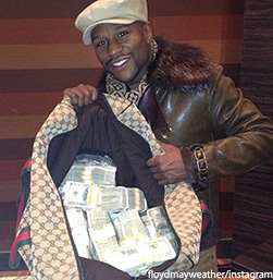 Mayweather flaunting his wealth