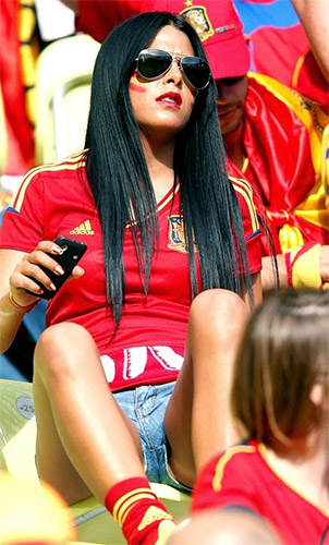 woman and men attend spain's soccer matches