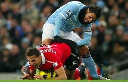 Tevez awkward position trying to get the ball from Behind Rio